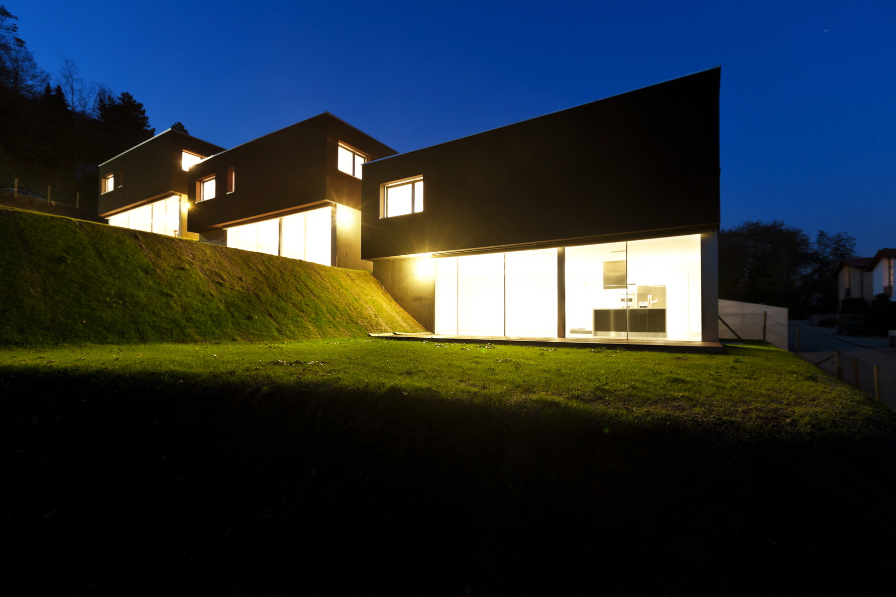 Modern House By Night Amg Architects
